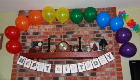 balloon rainbow over mantel